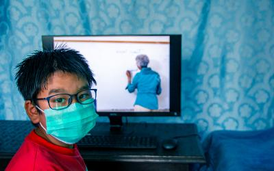 Nepalise child with computer learning online