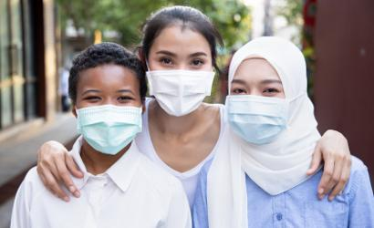 Diverse group of young people wearing facemasks