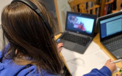 Schoolgirl working on laptop