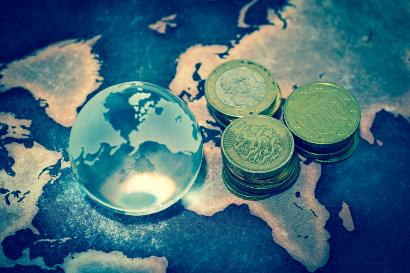 Shutterstock-509169151 Crystal globe with money on map