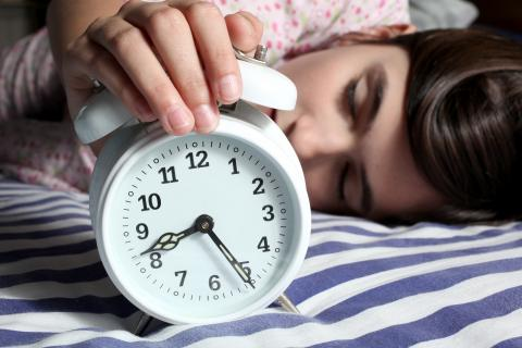 Shutterstock-525533599 Child and alarm clock