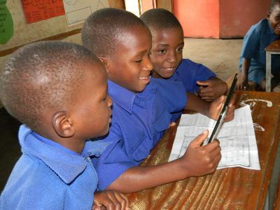 African school children using a tablet