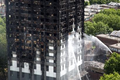 Shutterstock-667008772 Hoses dousing the fire at Grenfell Tower