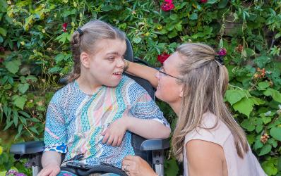 Disabled young girl with carer