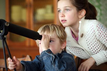Children looking through a telescope