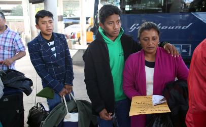 Migrant mother with two teenage sons