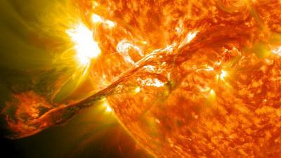 The sun emitting a sudden flash of light—a solar flare. NASA