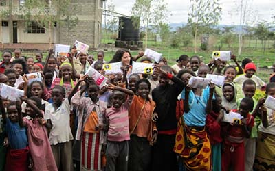 Maria Macnamara, founder of Smalls for All and OU Honorary, with children in Africa