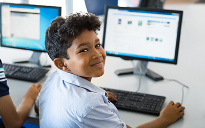 A primary school pupil using a computer