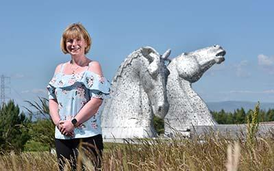 OU in Scotland graduate Emma, pictured in front of The Kelpies