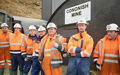 Workers outside the mine in new series Gold Town