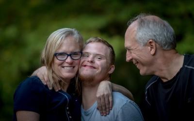 Three smiling people