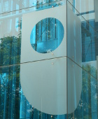Glass side of a building showing the OU logo