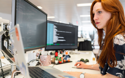 Woman looking at computer screens